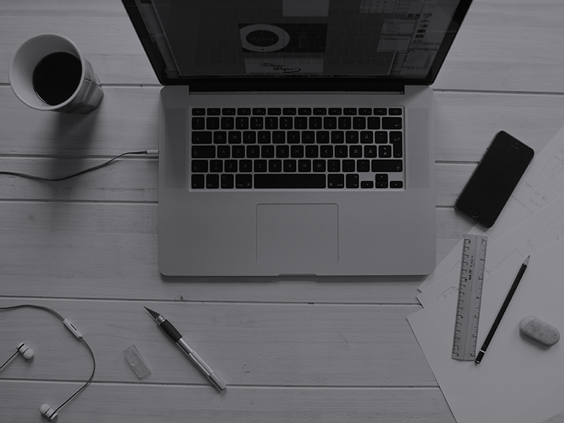 design blogs accepting guest posts - a workstation desk with a macbook, a smartphone, some papers, a cup of coffee, a pen & pencil, rule and a eraser